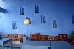 red moroccan textiles on chefchaouen blue terrace Moroccan Decor Living Room, Morrocan Decor, Moroccan Bedroom, Moroccan Interiors, Living Room Decor, Interior Wall Colors, Interior Desing, Interior Walls, Living Room Interior