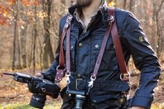 Inspired by gun holsters, the MoneyMaker is a leather harness that lets photographers carry multiple cameras. Each one is attached to clips that can slide up and down the harness for easy access. $175