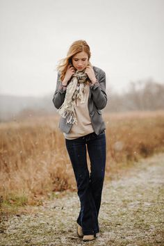 Business casual work outfit: Grey blazer, oatmeal top, dark denim jeans, I'd wear brown oxfords or boots.