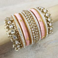 Pink bangles with white stones Indian Bridal Jewelry Sets, Bridal Bangles, Indian Jewelry, Silk Thread Bangles Design, Gold Bangles Design, Stylish Jewelry, Fashion Jewelry, Antique Jewellery Designs, Pearl Necklace Designs