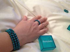 My wife playing with my buckyballs.. Available from perkalgifts.co.za