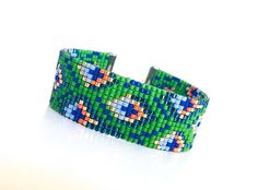 Loom bracelet, ethnic bracelet. The seed beads used in this Peacock loom bracelet are high quality glass Japanese Delicas. This bracelet includes a combination of green, blue, teal, gold and orange color seed beads. I used silver plated electrophoretic coating clasp. This loom bracelet can