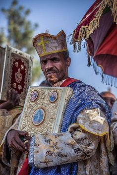 Priest with the colorful umbrella outside the St. Mary Zion Church-Axum-Ethiopia. https://ExploreTraveler.com