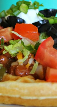 Chili Topped Cornbread Waffles ~ A nice warm and crispy cornbread waffle topped with chili, cheese, and all your favorite toppings