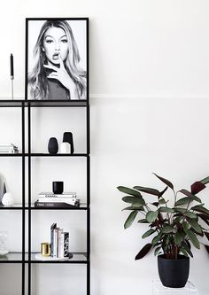 modern open shelves with minimal decor and black and white photography