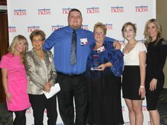 The National Down Syndrome Society honored Patti Saylor Wednesday night for her tireless advocacy on behalf of people with Down Syndrome.  Saylor (center right) is joined by Adam Saylor (center left) and daughter Emma Saylor (right, white top), Debra Alfarone (right) and others).