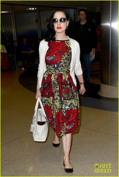 dita von teese returns to lax in same dress 01 Dita Von Teese's hair game is on point while arriving at LAX Airport on an inbound flight on Friday (June 12) in Los Angeles.    The 42-year-old burlesque star…