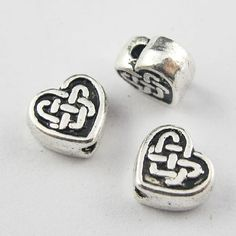 Tibetan Silver CELTIC KNOT HEART Heart 7mm Spacer Beads Charms offered by HalfPennyBoutique, $3.99 https://www.etsy.com/listing/161799764/tibetan-silver-celtic-knot-heart-heart