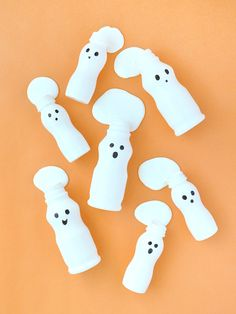 Empty plastic yogurt bottles are the perfect ghostly containers to hold slime this Halloween!
