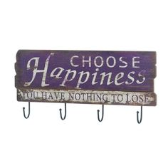 Be organized and happy when you put this vintage-style decor on your wall. Four iron hooks hang below a purple sign that reads Choose Happiness You Have Nothing To Lose. Choose Happiness Wall Hook by Rustica House. #myRustica