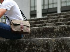 The NutSac Satchel is a men's bag designed to fit a standard sized tablet like an iPad. Made from waxed canvas and leather. Lifetime guarantee.
