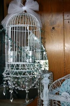 I just received a vintage birdcage, looking or ideas on how to design it. I don't want any live birds in my house LOL