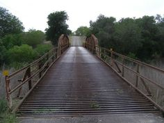 Ray Point TX Old Bridge. In 2009 it was due to be replaced and probably by now has been. When the old boards began to rot, pipe was laid. However, in freezing wet weather it wasn't able to be crossed. Beads were then added to break up ice. Yes, we do get ice in Texas. texasescapes.com