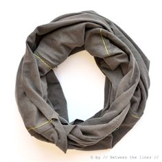 Make this light weight infinity scarf from an old T-shirt in just a few easy steps...