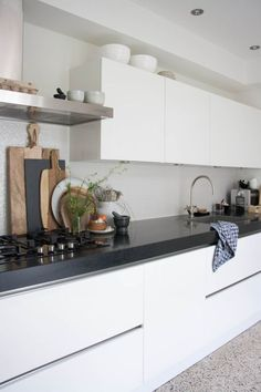 Black bench white cabinets