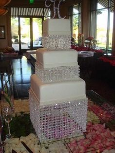 Chandelier Wedding Cake! Simple & slightly dramatic at the same time. Put an LED light underneathe for a full radiant effect!