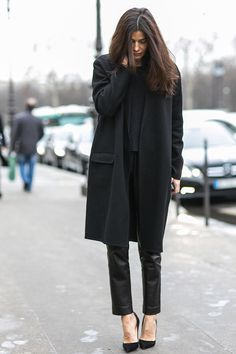 Effortlessly chic in leather trouser,sweater,and long black topper.paris