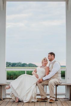 Bride and groom stand on dock at sunset, Creek Club at I'on, Charleston, South Carolina. Kate Timbers Photography. http://katetimbers.com #katetimbersphotography // Charleston Wedding Photography // Posing Photo Inspiration