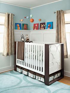 Beautiful calm and modern baby room ideas: two-toned crib, molding with picture rail and soothing blue. From Better Homes and Gardens.
