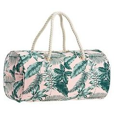 The Emily & Meritt Pink/Green Palms Rope Duffle: Bring a touch of tropical inspiration with you wherever you go! This durable duffle boasts a pretty-in-pink background with breezy banana leaf accents. Designed exclusively for PBteen by celebrity stylists and fashion designers Emily Current and Meritt Elliott, it captures their classic and rebellious aesthetic.