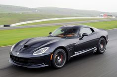 2013 SRT #Viper - front three-quarter view at speed in the rain