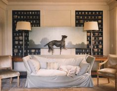 In the winter, there's a hidden beauty in the stark leafless trees and evergreen garden tapestries. Inside, successfully cozy interiors have added throws, burning fires and taxidermy. A lounging dog on a velvet draped sofa suits this blustery season.