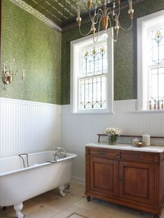 HOME TOUR: An Interior Designer's PCTURE PERFECT VICTORIAN HOME in Chicago <> The second-floor bathroom features the original claw foot tub and leaded glass windows, plus a Victorian cabinet topped with marble. Interior Windows, Home Interior, Bathroom Interior, Classic Interior, Leaded Glass Windows, Tin Ceiling Tiles, Ceiling Beadboard, Tin Tiles, Victorian Bathroom