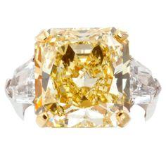 11.68 carat Fancy Intense Yellow Diamond Ring