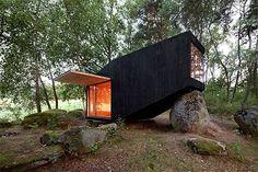 Bohemian forest retreat balances incognito on boulder