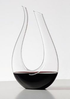 Aerate and enhance the bouquet, flavor and finish of your wine with the fashionable Riedel Amadeo Wine Decanter; a beautiful piece that's as functional as it is beautiful.