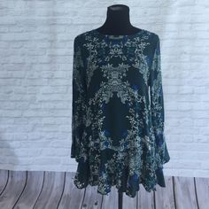 NWT Free People Open Back Tunic I got this free people open back tunic from stitch fix but I don't love the way it looks on me! Has all the tags still on it. I've only tried it on. Size M! Free People Tops Tunics