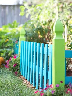 Make your garden stand out with a fence that pops! More gardening trends: http://www.bhg.com/home-improvement/porch/outdoor-rooms/colorful-backyard-decorating-ideas/?socsrc=bhgpin032913colorfulfence
