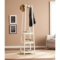 The Southern Enterprises Adams Coat Rack brings a unique place to hang your personal items. With 8 hooks and 3 open shelves, it's perfect for a closet, dressing area or hall. The mirrored top swivels 360 degrees for added convenience.