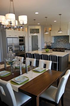 Love the lighting, the white cabinets with the stainless appliances, the glass door with upper window Pantry (could have frosted it with wording).