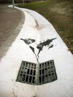 World Going Down the Drain, Spain -  Street Art That Cleverly Interact With Their Surroundings