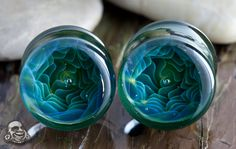 Pyrex glass blue/green squid throat plugs. Nice but very odd.