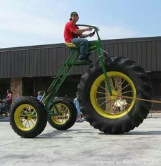Wow! Who would take this trike for a spin? #johndeere