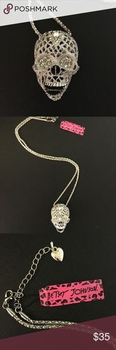 NWT BETSEY JOHNSON silver skull 💀 necklace BRAND NEW WITH TAGS BETSEY JOHNSON brand all silver skull. It's shimmery metal is made even more lively with clusters of crystals inside of its eyes and an upside down tear drop crystal on its forehead. The jaw has hinges so it opens and closes. The back of the skull is patterned in little heart shaped designs. A unique and interesting piece to add to your Betsey collection! BETSEY JOHNSON Jewelry Necklaces
