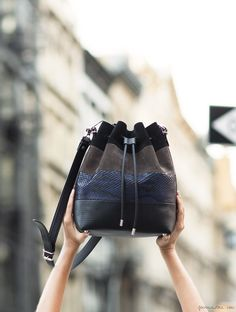 Hmm different layers and textures  on a bucket bag. Nice. Proenza Schouler bucket bag / Garance Doré