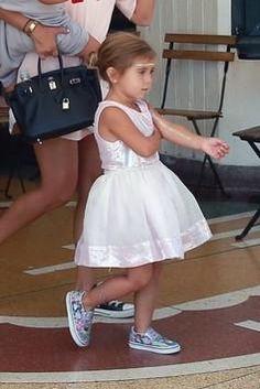 Penelope Disick wearing Vans Disney Classic Slip-on in Wonderland/Pink