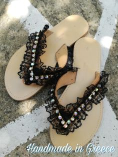 Handmade leather sandals, decorated with black laces and Swarovski chain..