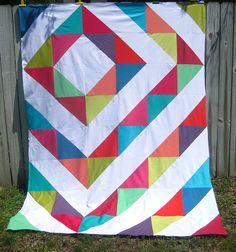 modern quilt top with half-square triangles and kona solids by kelby sews.