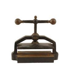 Bass Book Press at Found Vintage Rentals. Vintage iron book press makes an excellent prop for a shoot or display table