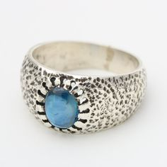 Blue kyanite oval cabochon ring in texture oxidized sterling silver band Free resizing  Gemstone measure: 6.5mm W x 8.5mm H  ~Shipping Note~ ***All items will ship by FedEx international shipping. Expected delivery times are between 3-5 days.