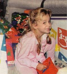 JonBenet Ramsey opening gifts of December 25th, 1996. This is one of the last photos taken of JonBenet, she was murdered roughly twelve hours after this photo was taken.