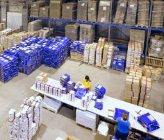 New and modern warehouse. Interior of the new and modern warehouse space with pe , Packaging Machine, Warehouse, Working People, Stock Photos, Building, Interior, Modern, Image, News