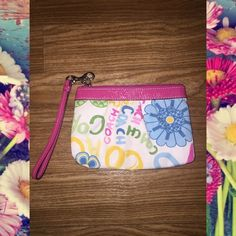 Coach Wristlet Cute Coach Wristlet. Has some wear as you can see from pic 3. But it's still very pretty and in good used condition. Coach Bags Clutches & Wristlets