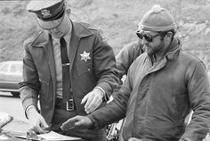 A Hells Angels member in a US Navy deck jacket gets fingerprinted, Bill Ray photo. Unknown: color of the watch cap. Outlaws Motorcycle Club, Motorcycle Clubs, Justin Thomas, Classic Harley Davidson, Hells Angels, Hard Wear, Second World, Us Navy, Military Fashion