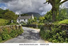 A pretty Cumbrian cottage near Grasmere, The Lake District, England. by Andrew Roland, via Shutterstock