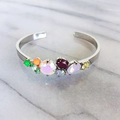 J. Crew Crystal Cluster Cuff Colorful crystal cluster cuff in perfect condition, worn once. No scratches or wear. This was made for a small wrist, there is no give to expand. Super fun for parties! J. Crew Jewelry Bracelets